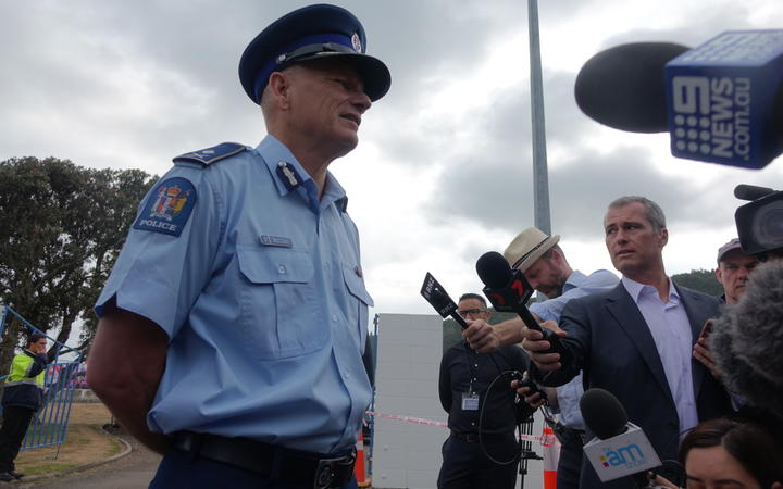 Deputy Commissioner Mike Clement speaks to media