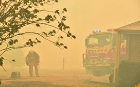 A firefighter at Balmoral, 150km south-west of Sydney, 19 December.