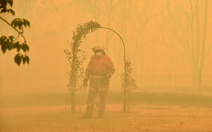 A fireman fights a bushfire to protect a property in Balmoral, 150 kilometres southwest of Sydney on December 19.