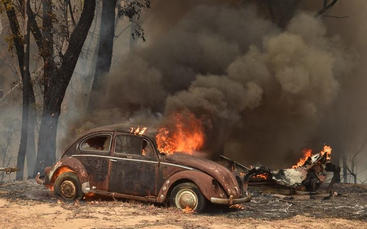 An old car burns from bushfires in Balmoral, 150 kilometres southwest of Sydney on December 19, 2019. -