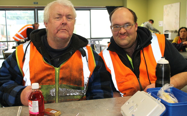 A photo of recycling team workmates, Ian Thompson and Andrew Doak sharing lunch in the canteen