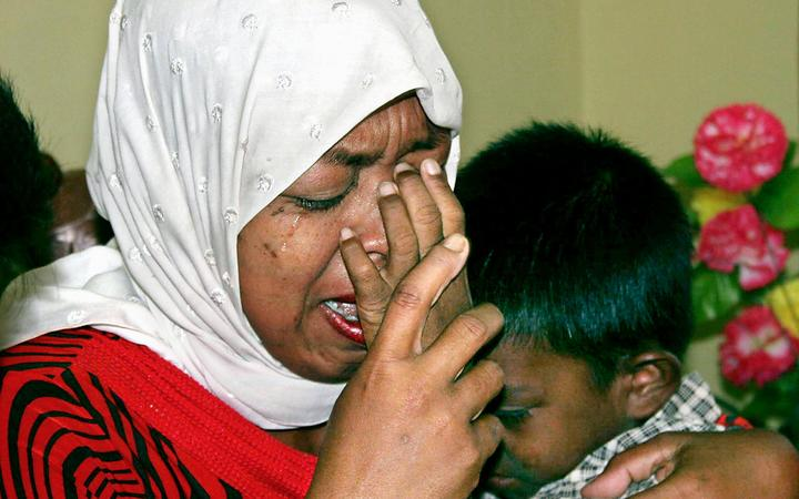 Indonesian Hayatun Nafis hugs her 10-year-old son Muhammad Nurwansyah after they were reunited in Banda Aceh, 15 February 2005, since the deadly 26 December 2004 tsunami.