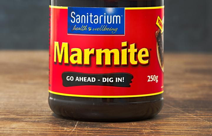 AUCKLAND, NEW ZEALAND - APRIL 02, 2016: A jar of Marmite, popular yeast extract product in New Zealand made by Sanitarium.