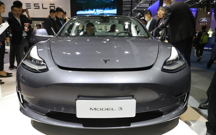 Tesla's Model 3 is displayed during China International Import Expo.