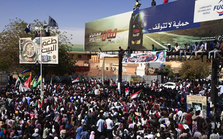 Sudanese protesters rally in front of a court in Omdurman near the capital Khartoum during the trial on December 30, 2019 of intelligence agents for the death of teacher Ahmed Al-Khair while in custody of intelligence services.