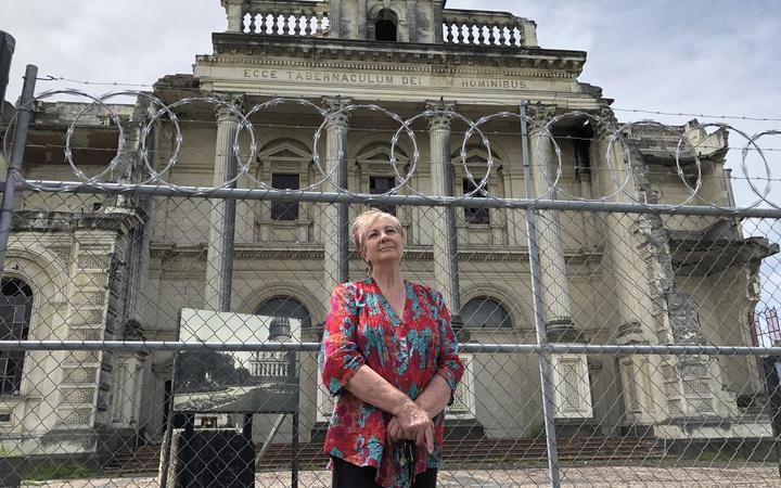 Anna Crighton, chair of Christchurch Heritage Trust,  in front of Christchurch's earthquake damaged Catholic Cathedral of the Blessed Sacrament