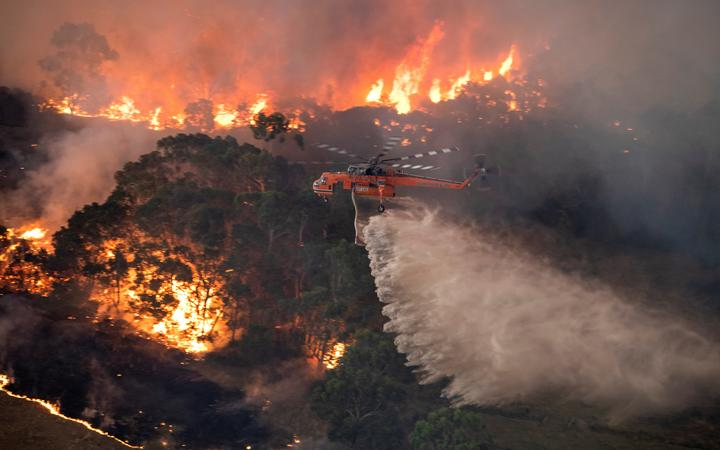 A helicopter fighting a bushfire near Bairnsdale in Victoria's East Gippsland region on 31 December, 2019.