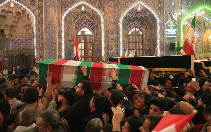 Mourners carry the coffins of slain Iraqi paramilitary chief Abu Mahdi al-Muhandis, Iranian military commander Qasem Soleimani and eight others inside the Shrine of Imam Hussein in the holy Iraqi city of Karbala during a funeral procession on 4 January.