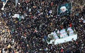 Massive crowds attend the funeral of military commander Qassem Soleimani, killed in a US drone attack.
