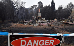 A woodchip mill burnt by bushfires in Quaama in Australia's New South Wales state on January 6, 2020.