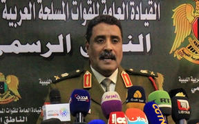Ahmad al-Mesmari, spokesman for Haftar's forces, addresses the media in the eastern Libyan city of Benghazi.
