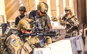 A handout picture received from the US embassy in Iraq on December 31, 2019, shows American soldiers taking position around the embassy in the capital Baghdad.