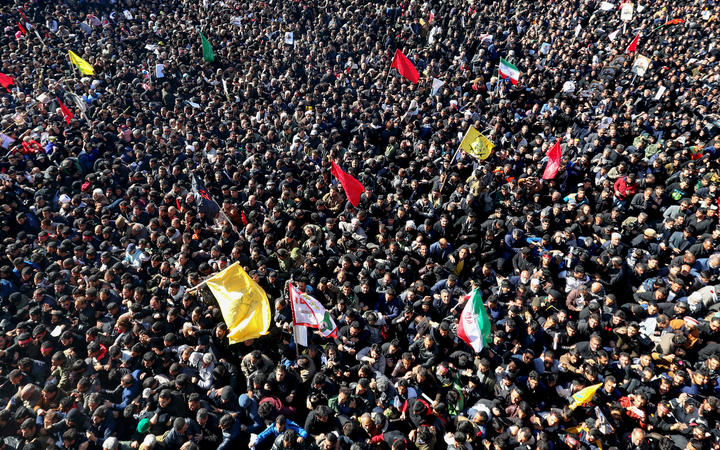 Iranian mourners gather during the final stage of funeral processions Qasem Soleimani, in his hometown Kerman.
