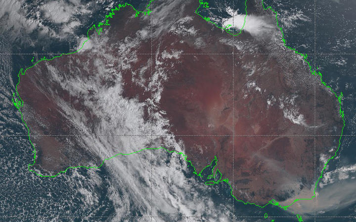This handout satellite image taken and received on January 3, 2020 from the Japan Meteorological Agency shows an image from the Himawari-8 satellite of Australia, with smoke (bottom R) from bushfires visably drifting off the coast of southeast New South Wales state.