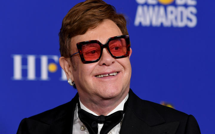 BEVERLY HILLS, CALIFORNIA - JANUARY 05: Elton John poses in the press room with the award for Best Original Song - Motion Picture during the 77th Annual Golden Globe Awards at The Beverly Hilton Hotel on January 05, 2020 in Beverly Hills, California.   Kevin Winter/Getty Images/AFP