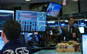 Traders work on the floor of the New York Stock Exchange (NYSE) on January 08, 2020 in New York City. As tensions with Iran continue to concern global markets, the Dow Jones industrial average opened 7 points up on Wednesday, after futures tumbled more than 400 points late Tuesday.