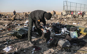 Rescuers search debris after a Ukrainian airplane carrying 176 people crashed on Wednesday shortly after takeoff from Tehran airport