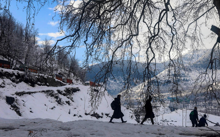 Students on the way to internet during a Kashmir winter.