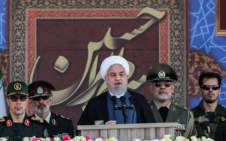 "Iranian President Hassan Rouhani  giving a speech during the annual ""Sacred Defence Week"" military parade today."