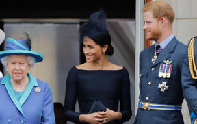 Queen Elizabeth II, Meghan, Duchess of Sussex, Prince Harry, Duke of Sussex stand on the balcony of Buckingham Palace on July 10, 2018.