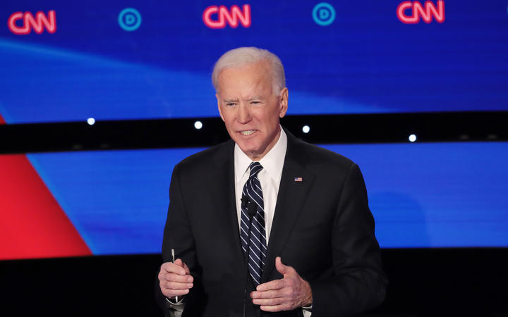 Former Vice President Joe Biden delivers his closing statement during the Democratic presidential primary debate at Drake University