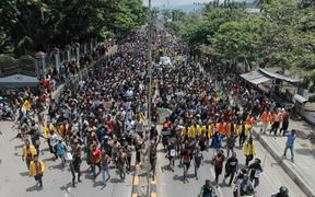 Protesters march in Jayapura.