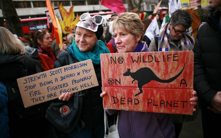 Members of climate change activist movement Extinction Rebellion (XR) protest the Australian government's response to its ongoing bushfires emergency at a demonstration outside the Australian High Commission in London, England.