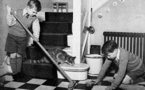 Young children completing household tasks
