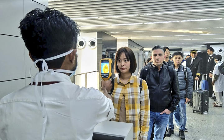 The Ministry of Civil Aviation uses a thermographic camera to screen the head of people at Netaji Subhash Chandra Bose International Airport in Kolkata following the outbreak of CoV2019.