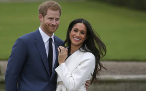 Britain's Prince Harry and his wife Meghan will give up their titles and stop receiving public funds following their decision to give up front-line royal duties, Buckingham Palace said on January 18, 2020.