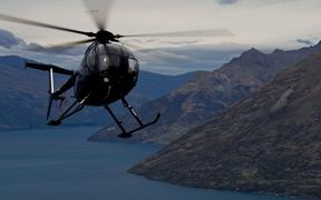 A helicopter circling over Queenstown, New Zealand.