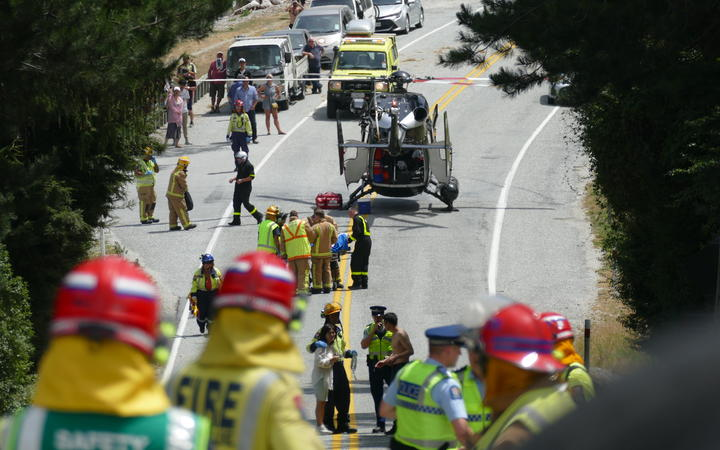 Emergency services at the scene of the crash on the Queenstown-Glenorchy Rd, near Queenstown, on Tuesday 21 January.