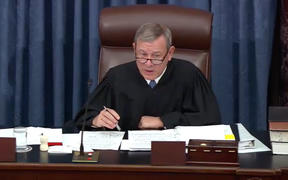 Chief Justice of the United States John G. Roberts, Jr presides as the US Senate considers an amendment to US Senate Resolution 483, during the impeachment trial of US President Donald J Trump.