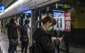 A woman wears a mask as she waits for an MTR Train on a platform in Tsim Sha Tusi on January 22, 2019 in Hong Kong, China.