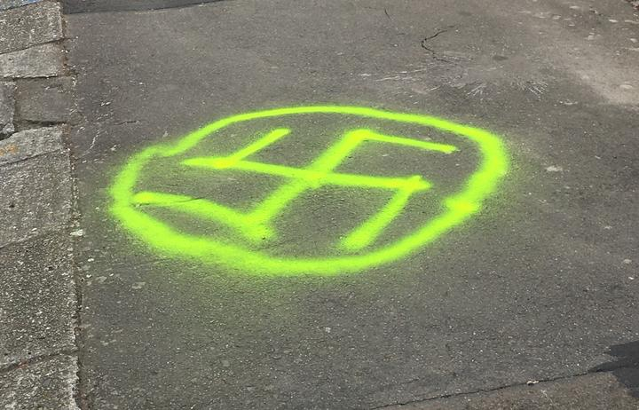 A swastika spray-painted outside Temple Sinai.