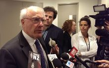 Sir Geoffrey Palmer speaks to the media after appearing before a parliamentary committee.