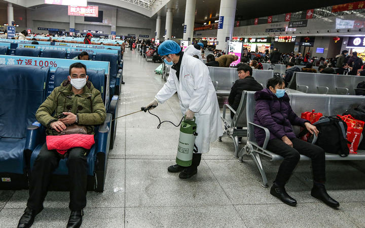 A worker disinfecting the waiting area at a railway station in Nanchang, in China's central Jiangxi province. 22 January.