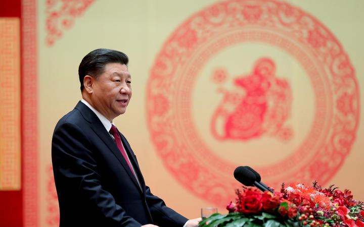 Chinese President Xi Jinping addresses a Chinese Lunar New Year reception at the Great Hall of the People in Beijing.