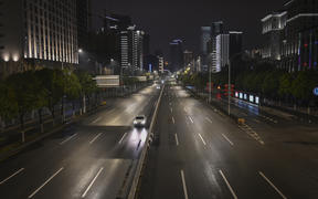 General view of a street in Wuhan on January 26, 2020, a city at the epicentre of a viral outbreak that has killed at least 56 people and infected nearly 2,000. - China on January 26 expanded drastic travel restrictions to contain an epidemic that has killed 56 people and infected nearly 2,000,