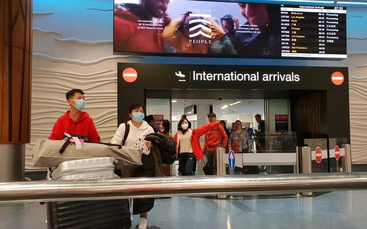 Passengers from international flights at Auckland Airport on Monday 27 January, after flights from Guangzhou and Shanghai had touched down.