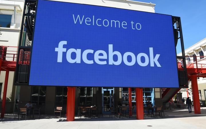 (FILES) In this file photo taken on October 23, 2019 a giant digital sign is seen at Facebook's corporate headquarters campus in Menlo Park, California.