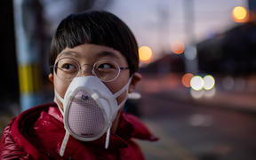 A child in Beijing, wearing a protective mask, 29 Janaury.