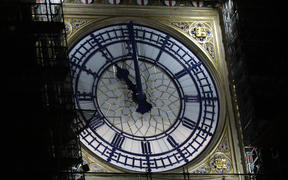 The clock face of Elizabeth Tower, known more commonly after the name of bell inside, Big Ben, shows the hands at eleven o'clock at night, at the Houses of Parliament in central London on January 31, 2020.