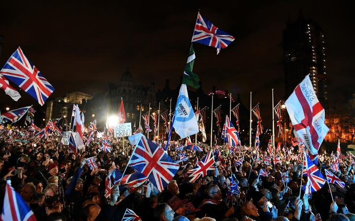 Brexit supporters wave Union flags as they gathered in Parliament Square.