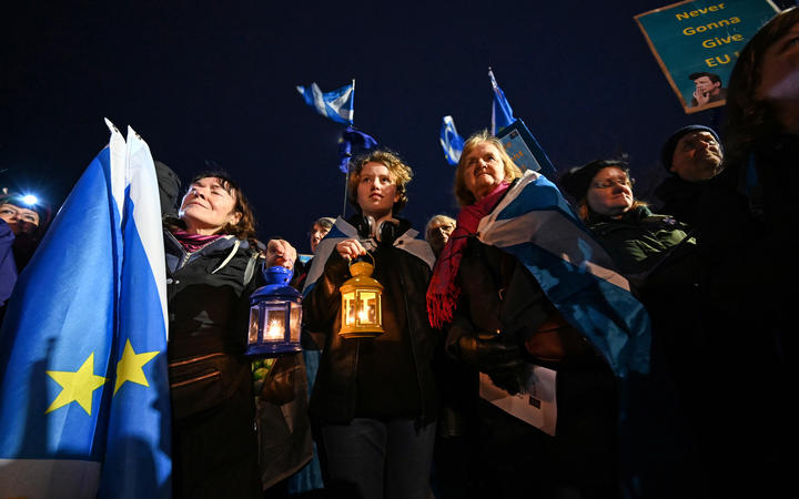 Protesters hold candle lamps during a protest by anti-Brexit activists in Edinburgh/
