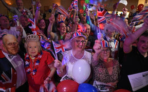 Brexit supporters wave Union flags as the time nears 11 O'Clock at a Brexit Celebration party at Woolston Social Club in Warrington, north west England on January 31, 2020, the day that the UK formally leaves the European Union.