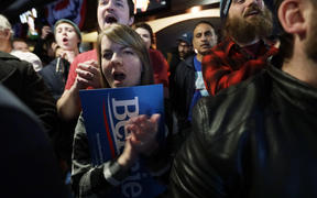 Supporters cheer during a campaign event of Democratic presidential candidate Senator Bernie Sanders in Des Moines, Iowa, 2 February.