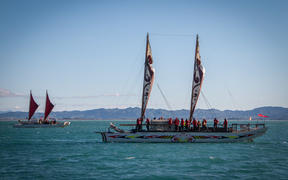 The waka flotilla arrives in the bay as part of the Tuia 250.