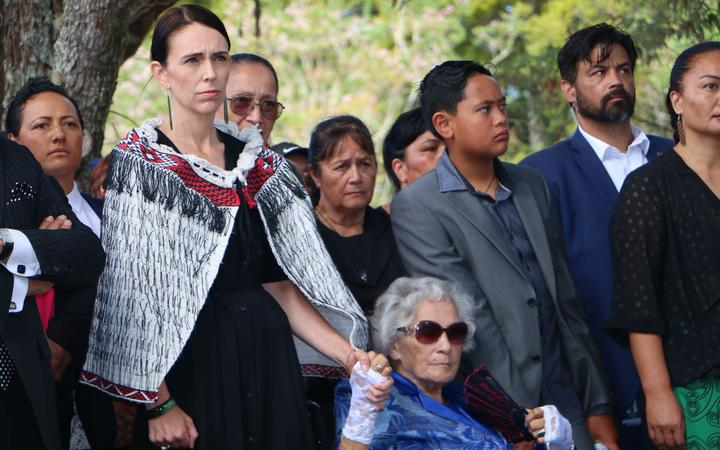 Prime Minister Jacinda Ardern holding hands with Titewhai Harawira as they are welcomed on to the Waitangi Treaty grounds.