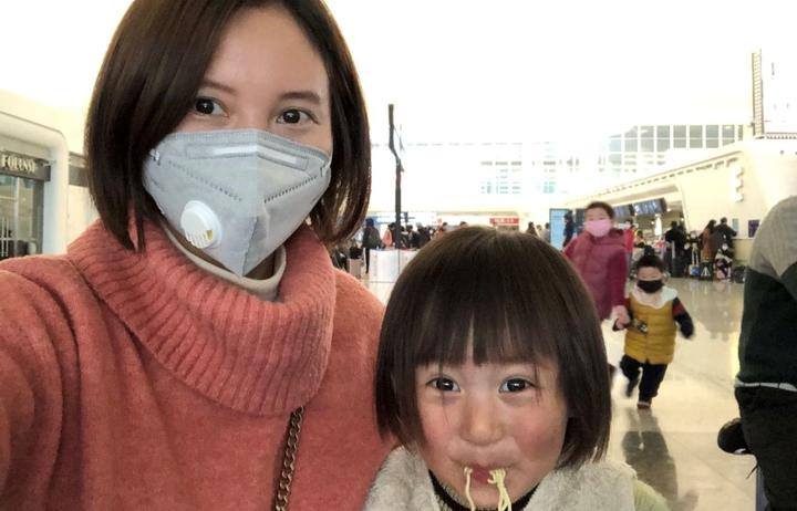 Lily Gao and her two-year-old daughter Elysse at the Wuhan airport, waiting to be evacuated by a government-chartered flight.